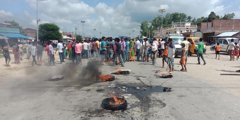Locals blocking the road accusing police of not doing enough to search for Kari Devi Yadav, who was allegedly abducted, in Siraha, on Tuesday, August 21, 2018. Photo: THT