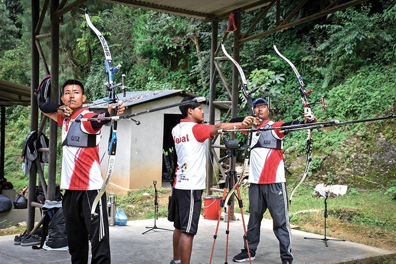 (From left) Roshan Nagarkoti, Tilak Pun Magar and Min Prasad Gauchan take aim during a training session in Kathmandu on Sunday. Photo: Naresh Shrestha/ THT