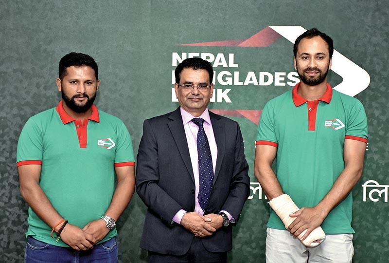 National cricket team members Sharad Vesawkar (right) and Basant Regmi (left) with Chief Executive Officer of NB Bank Gyanendra Prasad Dhungana in Kathmandu on Sunday. Photo: THT