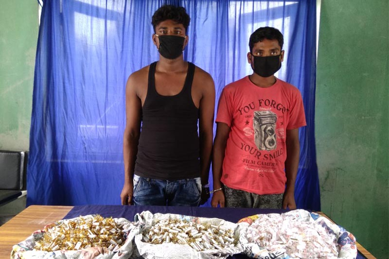 Police making public the suspects along with seized controlled drugs at Parsa District Police Office on Sunday. Photo: Ram Sarraf