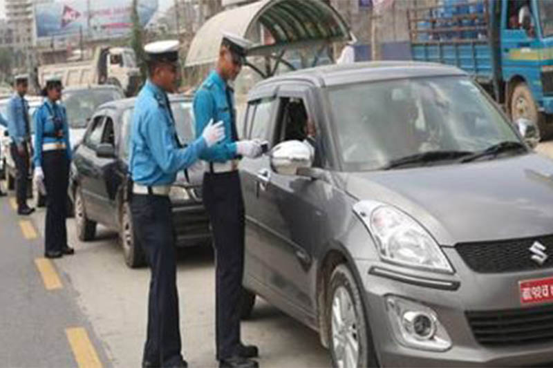 File: Traffic police checking vehicle documents in Kathmandu. Courtesy: MPTD