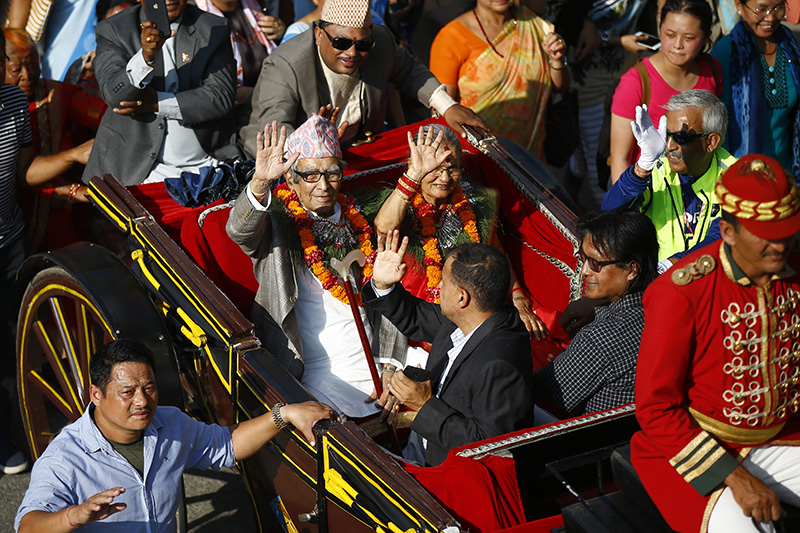 National Poet 'Rastrakavi' Madhav Prasad Ghimire waves during a rally in celebration of his 100th birthday, in Kathmandu, on Saturday, September 29, 2018. Ghimire is widely known by readers of Nepali literature for his patriotic writings. Photo: Skanda Gautam/THT