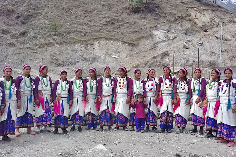 Local women clad in their traditional attires pose for a portrait in Gaumul Rural Municipality of Bajura district, on Monday, September 18, 2018. Photo: RSS