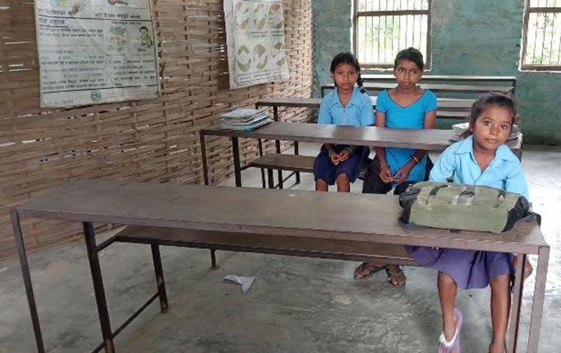 Three students attending classes at Balahi Foundation School in Sukhipur Municipality, Siraha, on Wednesday, September 12, 2018. Photo: THT