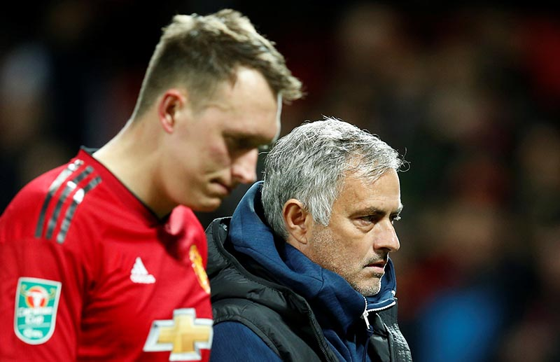 Manchester United's Phil Jones and manager Jose Mourinho look dejected after Derby County win the penalty shootout during the Carabao Cup, Third Round match between Manchester United and  Derby County, at Old Trafford, in Manchester, Britain, on September 25, 2018. Photo: Reuters