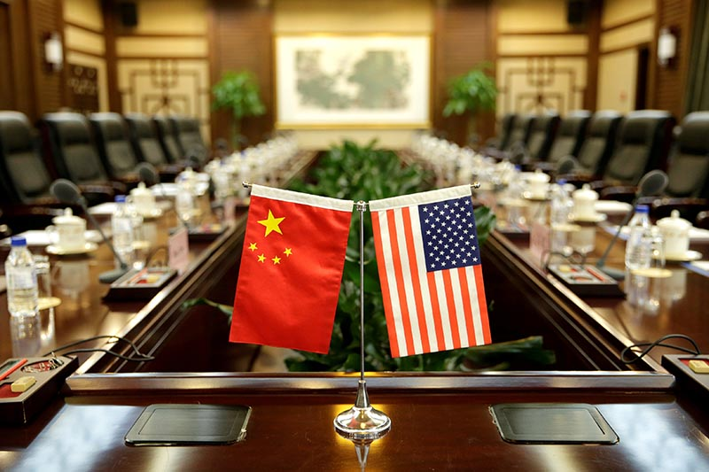 Flags of US and China are placed for a meeting at the Ministry of Agriculture in Beijing, China, June 30, 2017. Photo: Reuters
