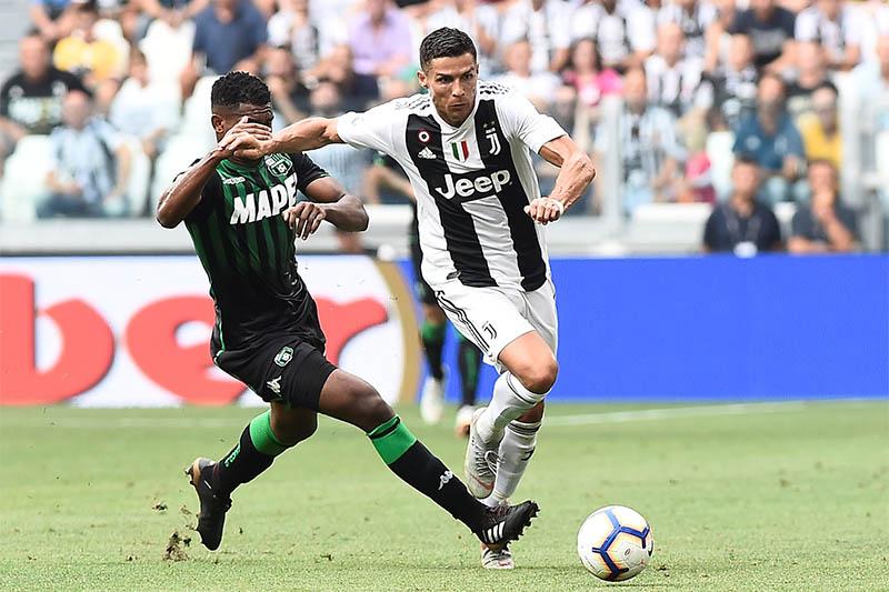 Juventus' Cristiano Ronaldo in action with Sassuolo's Marlon. Photo: Reuters