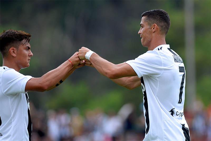 File: Juventus' Cristiano Ronaldo with Paulo Dybala. Photo: Reuters