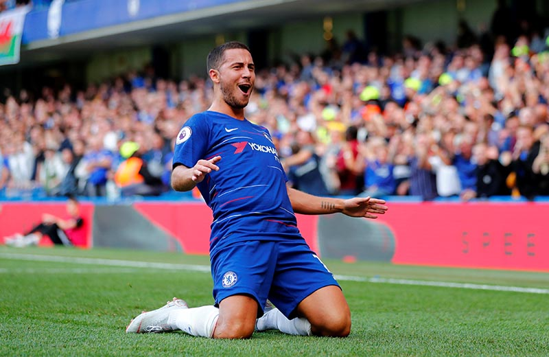 Chelsea's Eden Hazard celebrates scoring their first goal during the Premier League match between  Chelsea and Cardiff City, at Stamford Bridge, in London, Britain, on  September 15, 2018. Photo: Reuters