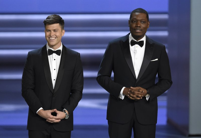 Hosts Colin Jost, left, and Michael Che speak at the 70th Primetime Emmy Awards on Monday, Sept. 17, 2018, at the Microsoft Theater in Los Angeles. Photo: APn