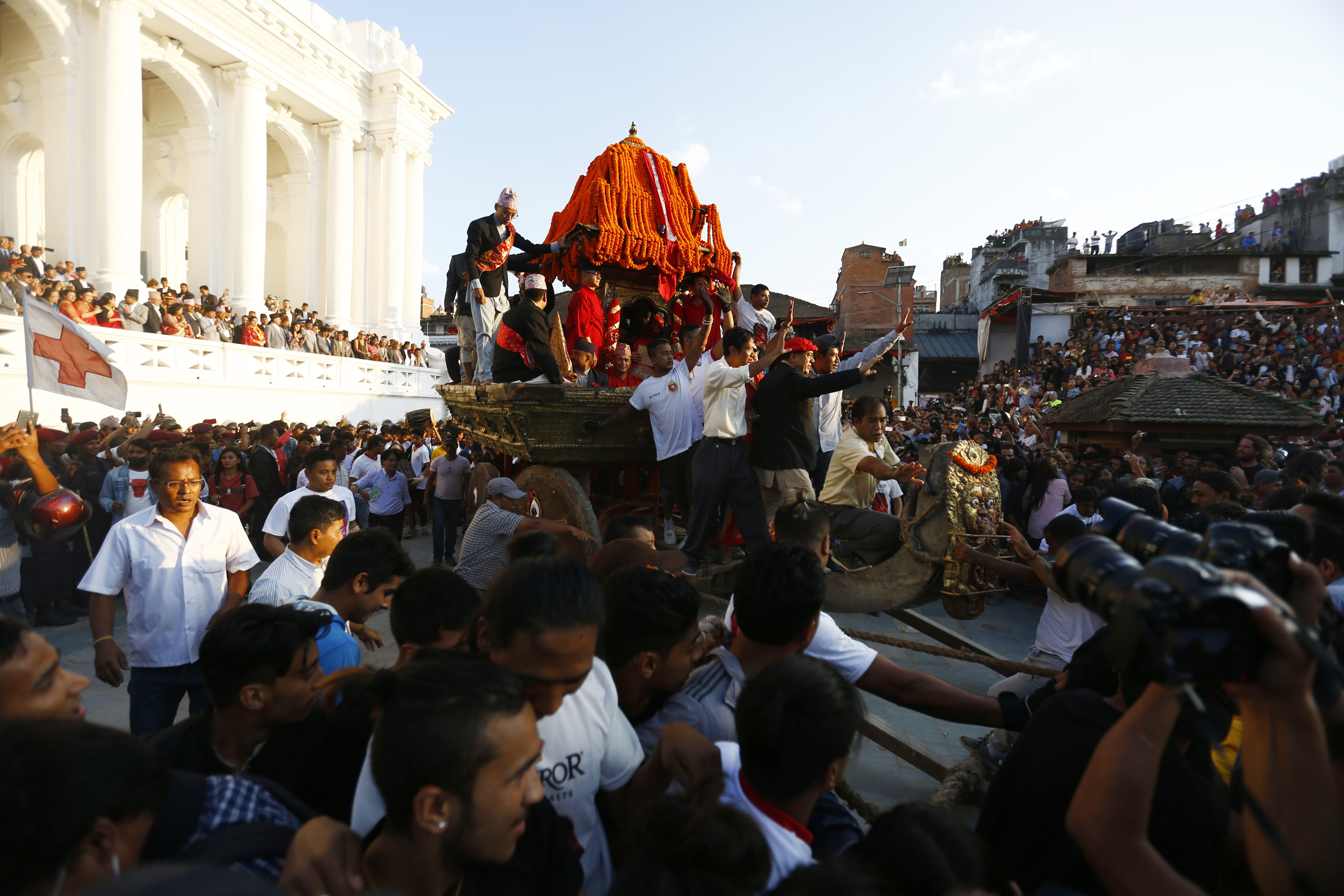 Nepali devotees pull a chariot of the Living Goddess Kumari during Indra Jatra festival, celebrated to honour Indra, the king of heaven and lord of rains, in Kathmandu, on Monday, September 24, 2018. Indra Jatra is the biggest religious street festival held annually in Nepal celebrated by singing, dancing and rejoicing. Devotees offer prayers along with other rituals in the eight-day festival celebrated by both Hindus and Buddhists. Photo: Skanda Gautam/THT