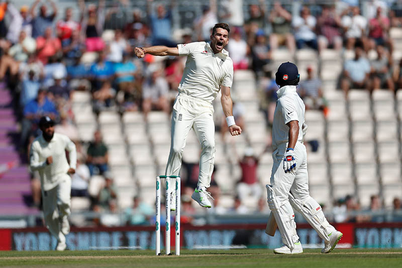 England's James Anderson celebrates taking the wicket of India's Shikhar Dhawan. Photo: Reuters