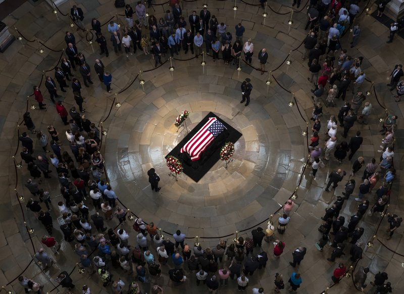 Members of the public walk past the flag-draped casket bearing the remains of John McCain of Arizona, who lived and worked in Congress over four decades, in the U.S. Capitol rotunda in Washington, on Friday, Aug. 31, 2018. Photo: AP