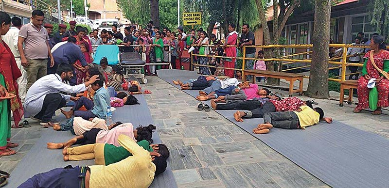 Patients receiving treatment on the floor at Dhulikhel Hospital, in Kavre, on Saturday. Photo: THT