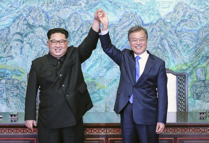 FILE - In this photo, North Korean leader Kim Jong Un, left, and South Korean President Moon Jae-in raise their hands after signing a joint statement at the border village of Panmunjom in the Demilitarized Zone, South Korea on  April 27, 2018. Photo: AP