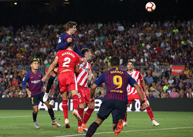 Barcelona's Gerard Pique scores their second goal during the La Liga Santander match between FC Barcelona and Girona, at Camp Nou, in Barcelona, Spain, on September 23, 2018. Photo: Reuters