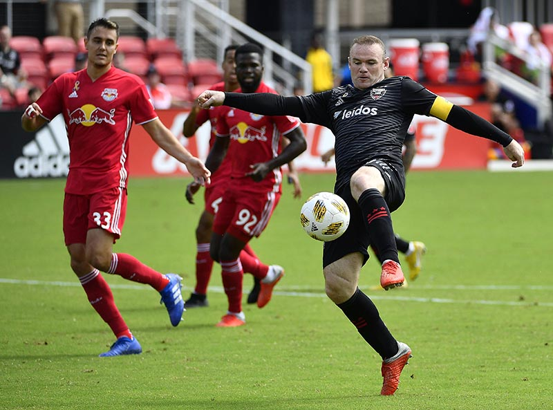 DC United forward Wayne Rooney (9) attempts a shot against the New York Red Bulls during the first half at Audi Field, in Washington, DC, USA, on Sep 16, 2018. Photo: Brad Mills-USA TODAY Sports via Reuters