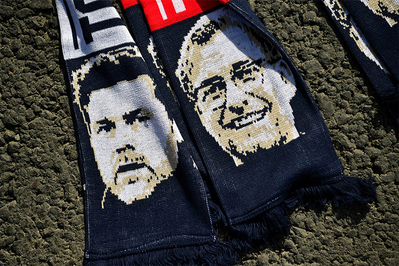 General view of a scarf depicting Tottenham manager Mauricio Pochettino and Liverpool manager Juergen Klopp. Photo: Reuters