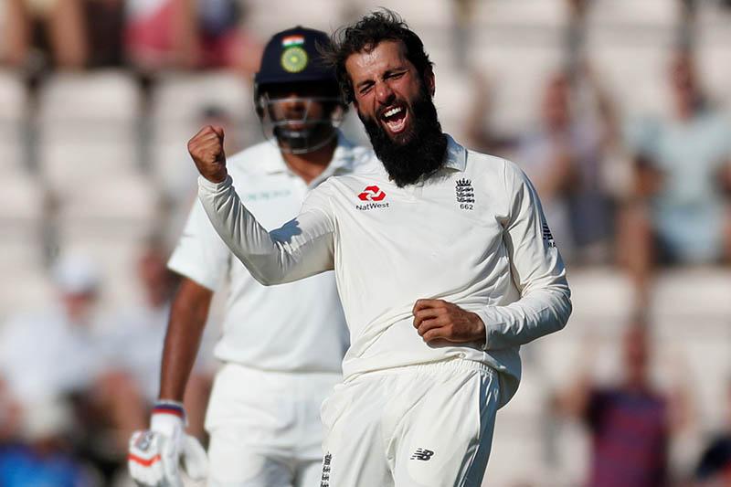 England's Moeen Ali celebrates the wicket of India's Ajinkya Rahane. Photo: Reuters