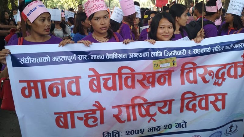 Women representatives of various organisations including rights activists holding a banner while taking part in a rally organised by the Ministry of Women, Children and Senior Citizen to mark the 12th National Day against Human Trafficking, at Bhrikuti Mandap, Pradarshani Marga, Kathmandu, on Wednesday, September 5, 2018. Photo: Suresh Chaudhary/THT Online
