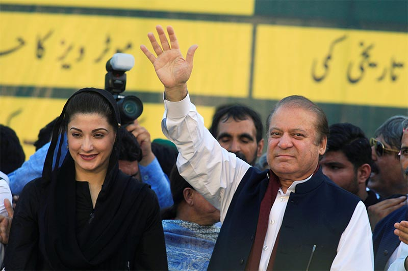 File: Nawaz Sharif (R), former Prime Minister and leader of Pakistan Muslim League, gestures to supporters as his daughter Maryam Nawaz looks on during party's workers convention in Islamabad, Pakistan June 4, 2018. Photo: Reuters