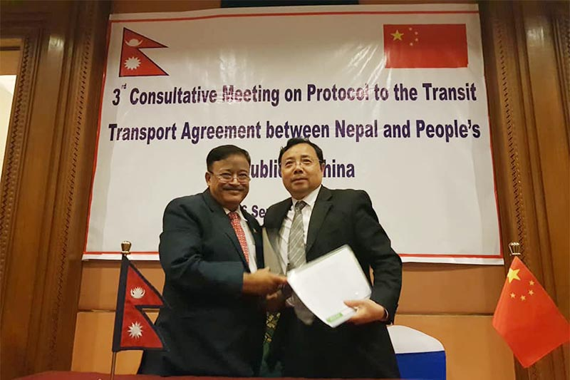 Joint secretary at the Ministry of Industry, Commerce and Supplies, Ravi Shanker Sainju (left) and Director General of Transport Department of China Wang Suiping smile after signing the agreement as 3rd Consultative Meeting on Protocol to the Transport Agreement between Nepal and China concludes, in Kathmandu, on Friday, September 7, 2018. Photo: THT
