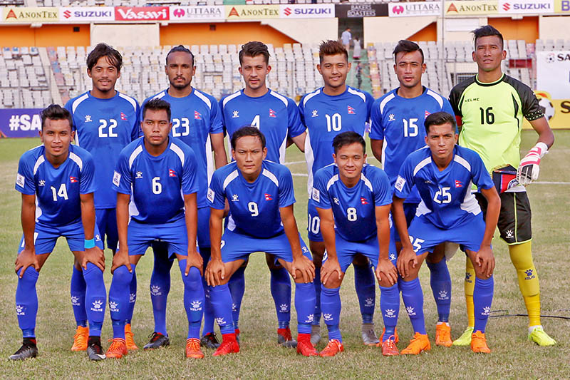Nepal football team players pose for a portrait prior to their game against Bhutan in SAFF Championship in Dhaka. Courtesy: ANFA