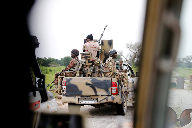 A Nigerian army convoy vehicle drives ahead with an anti-aircraft gun, on its way to Bama, Borno State, Nigeria August 31, 2016. Picture taken from inside a vehicle. Photo: Reuters/ File