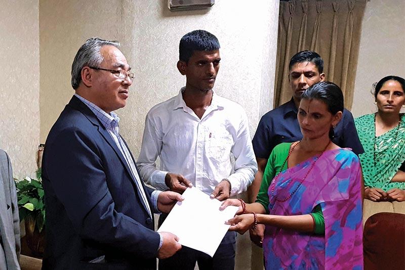 Nirmala Panta's father Yagya Raj and mother Durga Devi submitting a memo to Minister of Home Affairs Ram Bahadur Thapa, in Kathmandu, on Friday, September 14, 2018. Photo: THT