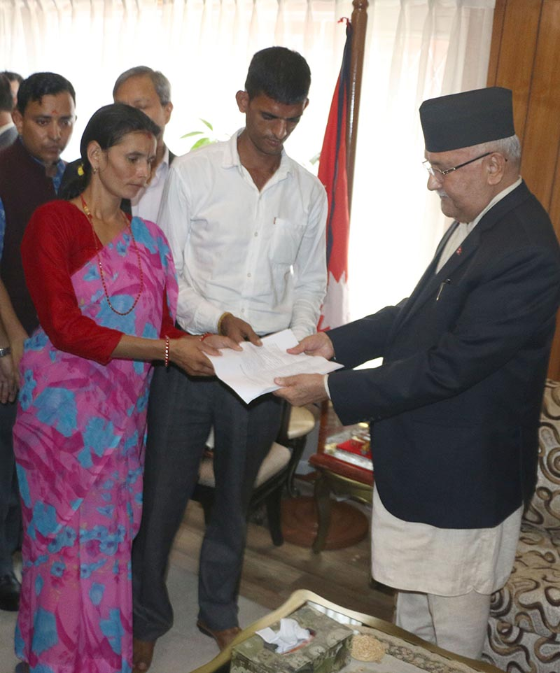 Nirmala Pantau2019s parents handing over a list of their demands to Prime Minister KP Sharma Oli at his official residence in Baluwatar, Kathmandu, on Monday, September 17, 2018. Photo: RSS