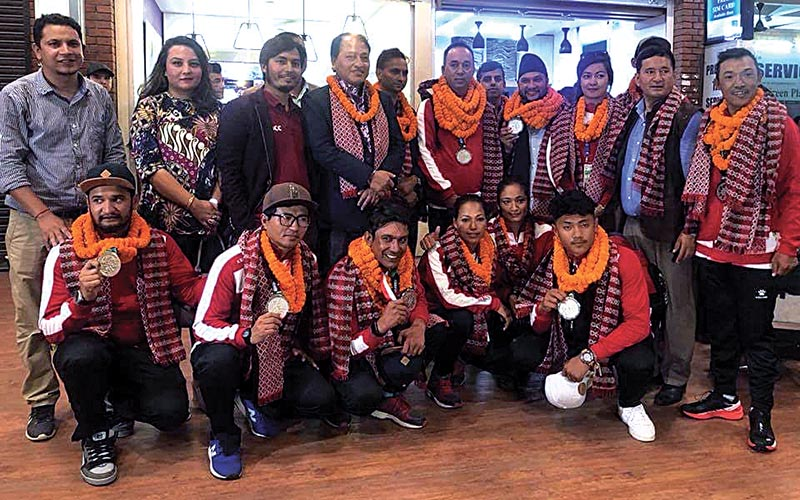 Paragliding team members with officials upon their arrival at TIA, Kathmandu on Sunday.