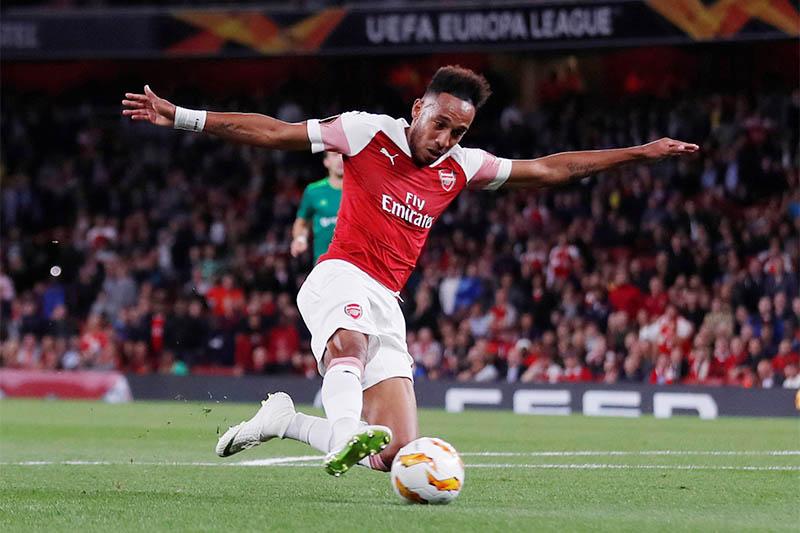 Arsenal's Pierre-Emerick Aubameyang scores their first goal. Photo: Reuters