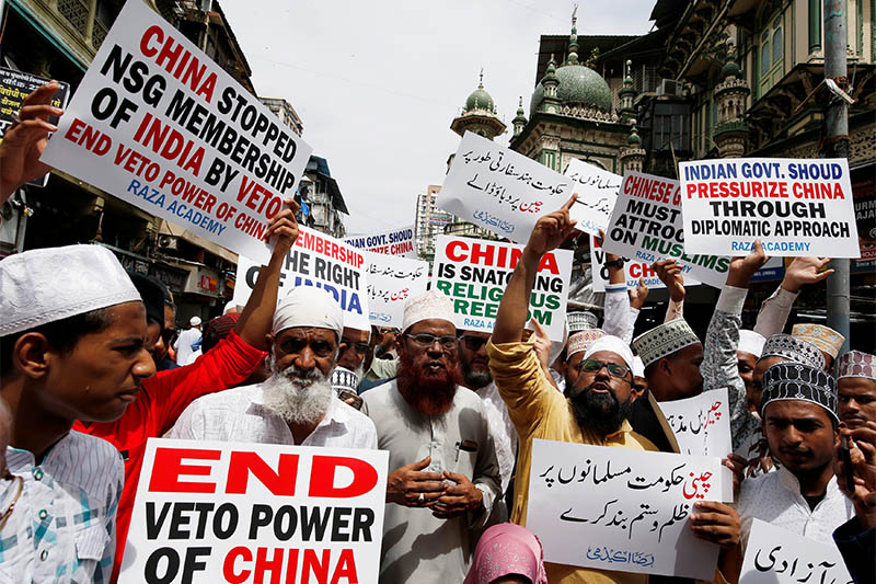 Protestors hold placards as they shout slogans during a protest against what they say is the Chinese government for detaining thousands of Uighur minority Muslims, at a street in Mumbai, India, September 14, 2018. Photo: Reuters