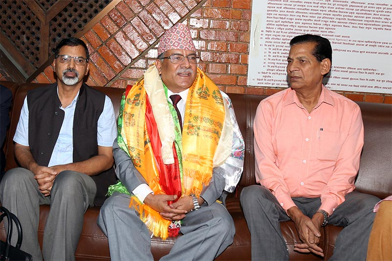 Nepal Communist Party (NCP) Co-chairperson Pushpa Kamal Dahal (centre) talking to mediapersons before leaving for China, at Tribhuvan International Airport in Kathmandu, on Saturday, September 15, 2018. Photo: RSS