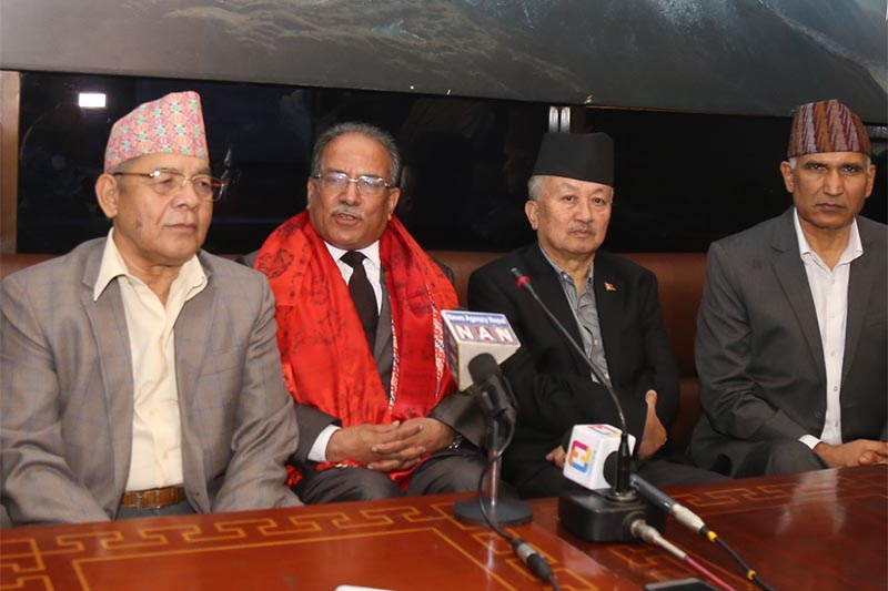 Nepal Communist Party (NCP) Co-chairperson Pushpa Kamal Dahal (centre) talks to mediapersons upon his arrival from Four-day China visit, at Tribhuvan International Airport, on Wednesday, September 19,  2018. Photo: RSS