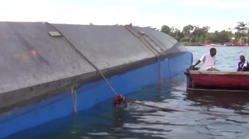 Rescue workers examine the hull of a ferry that overturned in Lake Victoria, Tanzania September 21, 2018, in this still image taken from video. Photo: Reuters TV via Reuters
