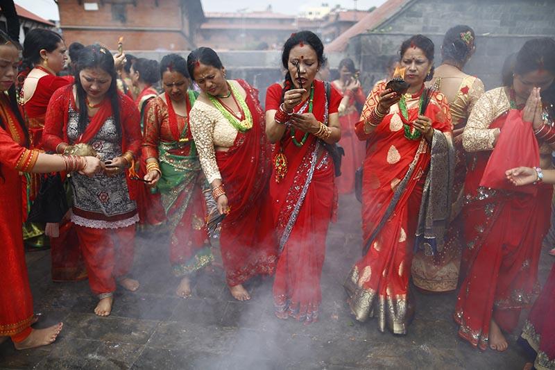 Hindu devoted women offer ritual prayers during Teej festival on the premises of  Pashupathinath Temple in Kathmandu,on Wednesday, September 12, 2018. Photo: Skanda Gautam/THT