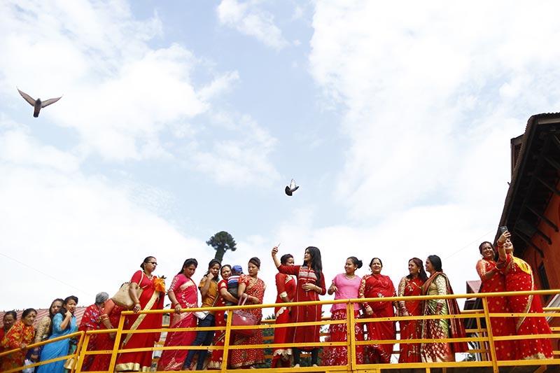 Devoted Hindu women queue up for paying obeisance to 'Shiva Linga' during Teej festival, at Pashupathinath Temple in Kathmandu, on Wednesday, September 12, 2018. Photo: Skanda Gautam/THT