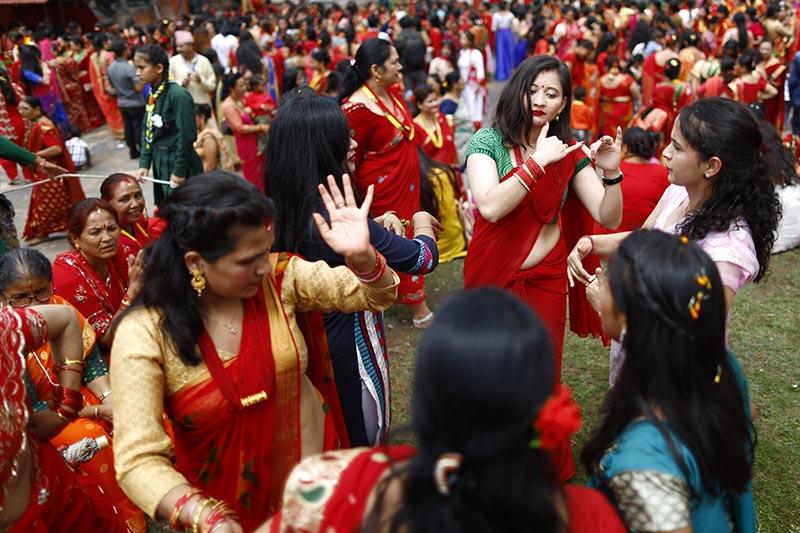 Devoted Hindu women dance and sing during Teej festival on the premises of Pashupathinath Temple in Kathmandu, on Wednesday, September 12, 2018. Photo: Skanda Gautam/THT