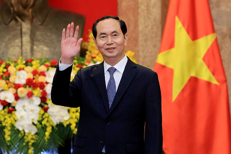 Vietnamese President Tran Dai Quang greets journalists as he waits for the arrival of Russian Foreign Minister Sergei Lavrov (not pictured) at the Presidential Palace in Hanoi, Vietnam March 23, 2018. Photo: Minh Hoang/Pool via Reuters