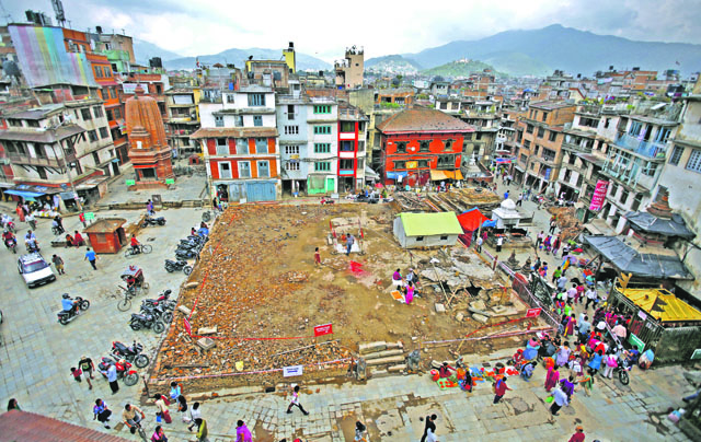FILE : People are seen around an area where Kashthamandap used to be before the earthquake. The heritage structure was completely destroyed in the massive earthquake of April 25. Photo: Skanda Gautam/ THT