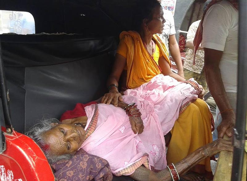 An ill elderly woman being taken to hospital in an e-rickshaw after transport service halted due to driversu2019 protest in Rajbiraj, Saptari, on Thursday, September 20, 2018. Photo: THT
