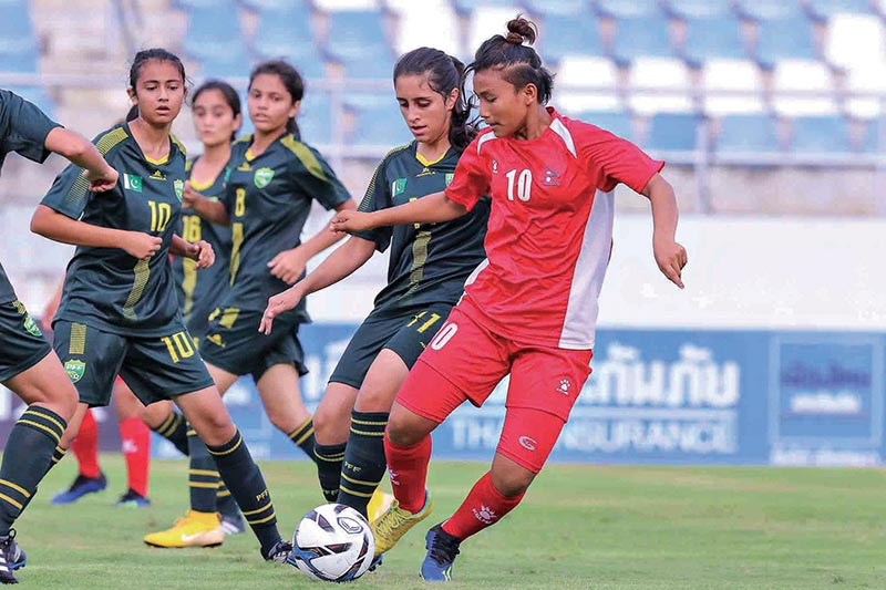 Nepal's Rashmi Kumari Ghising (right) vies for the ball with Pakistan Players during their AFC U-19 Women's Qualifier match in Thailand on Sunday. Photo Courtesy: NSJF
