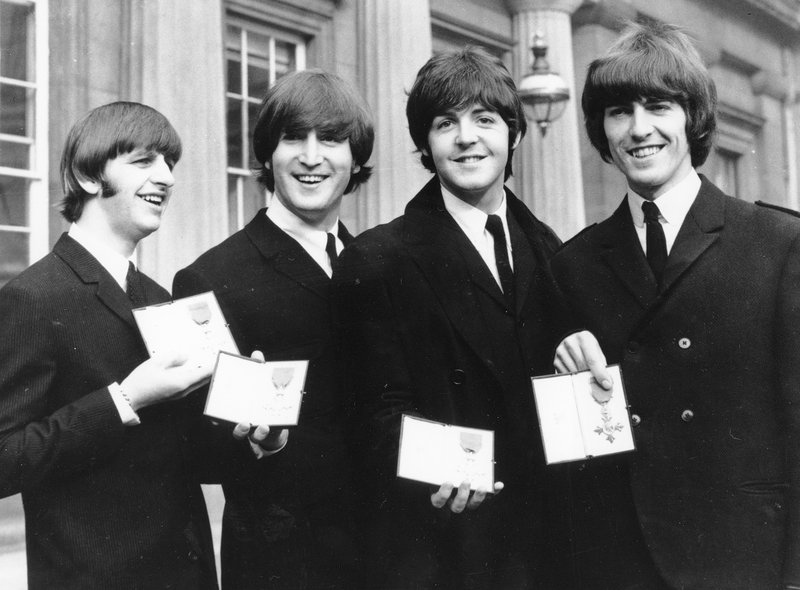 FILE - In this photo The Beatles, from left: Ringo Starr, John Lennon, Paul McCartney and George Harrison smile as they display the Member of The Order of The British Empire medals presented to them by Queen Elizabeth II in a ceremony in Buckingham Palace in London, England on Oct. 26, 1965. Photo: AP