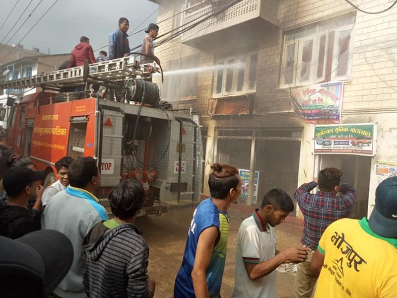 FILE: Security personnel and fire engines from Bhojpur Municipality attempt to douse fire that destroyed a house in Bhojpur, on Sunday, October 7, 2018. Photo: Niroj Koirala