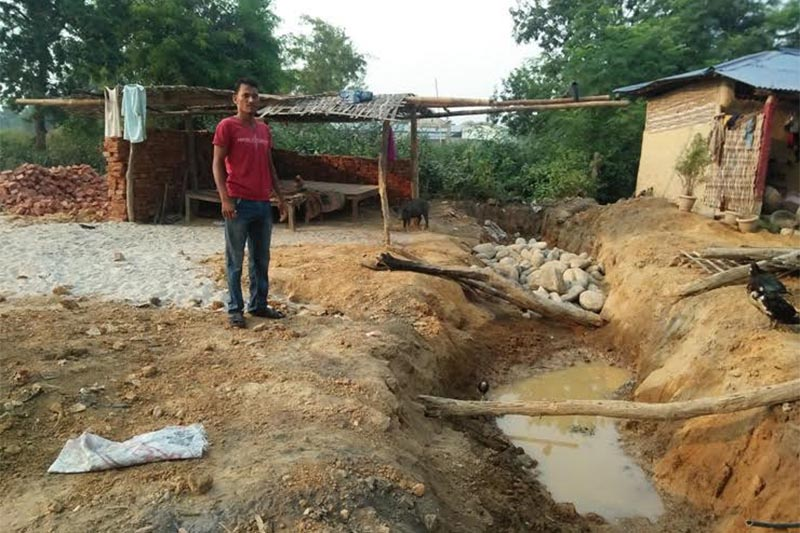 A person belonging to the Dom community looking at his house, which was destroyed by a local, in Naraha Rural Municipality, Siraha, on Wednesday, October 3, 2018. Photo: THT