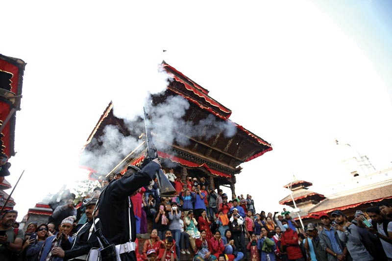 Nepalese soldiers dressed in traditional attire fire gunshot during Fulpati procession marking the seventh day of Dashain festival in Kathmandu, Nepal on Tuesday, October 16, 2018. Photo/Skanda Gautam