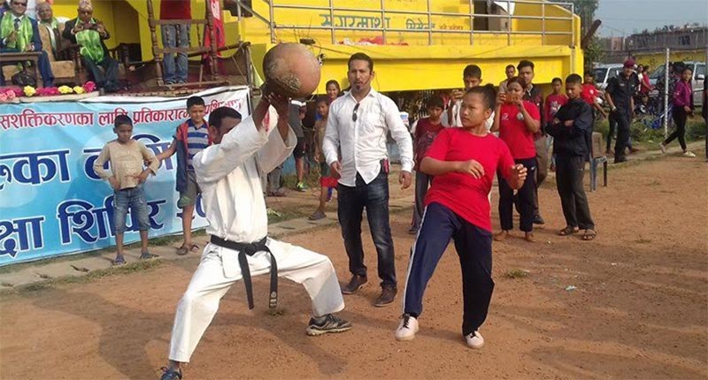 A participant exhibiting self defence skills at the graduation ceremony of the week-long training programme held in Dhangadi of Kailali district, on Friday, October 12, 2018. Photo: Tekendra Deuba/THT