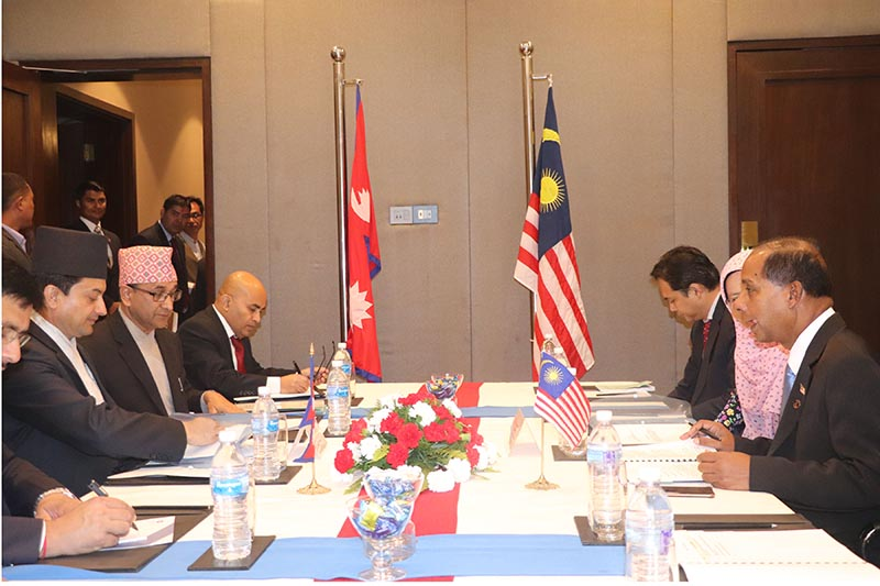 Minister for Labour, Employment and Social Security, Gokarna Bista (left) and Malaysian Minister for Human Resources, M Kulasegaran (right) take part in a ministerial level meeting before signing the Memorandum of Understanding (MoU) on the supply of labour, in Kathmandu, on October 28, 2018. Photo: RSS