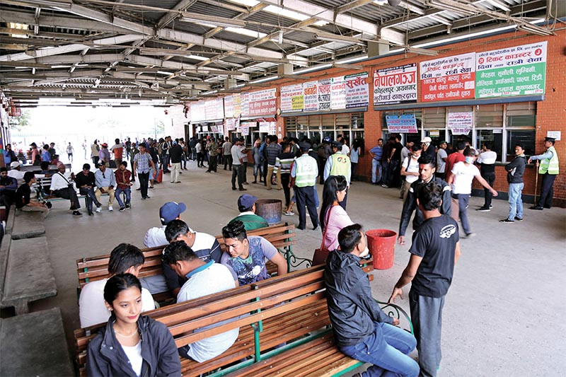 People thronging ticket counters to travel to their hometowns and villages at New Bus Park, Kathmandu, on Friday, October 12, 2018. Photo: THT